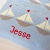Boats Knitted Cushion close up text