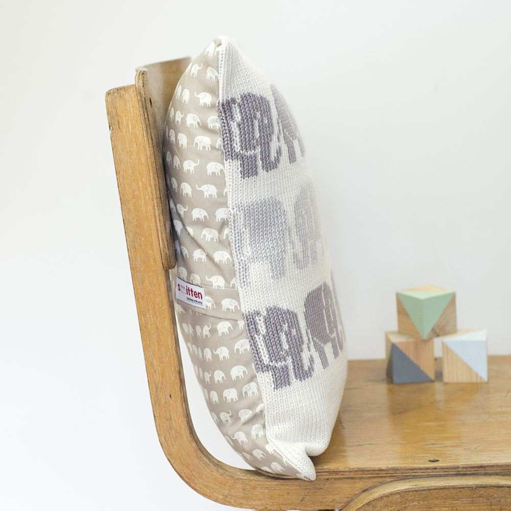 Elephants knitted cushion side view