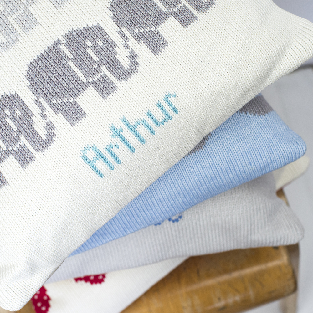 Elephants knitted cushion text close up