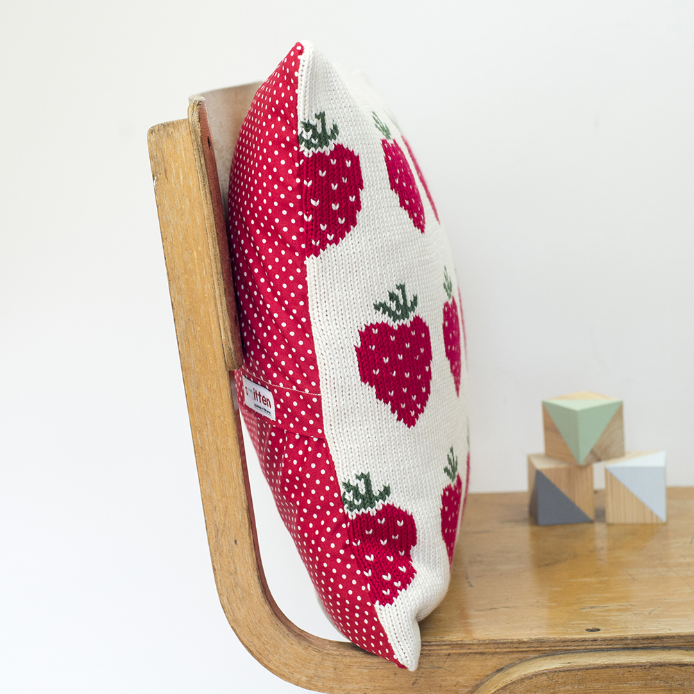 Strawberries knitted cushion side view