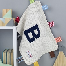 Navy initial knitted baby comforter