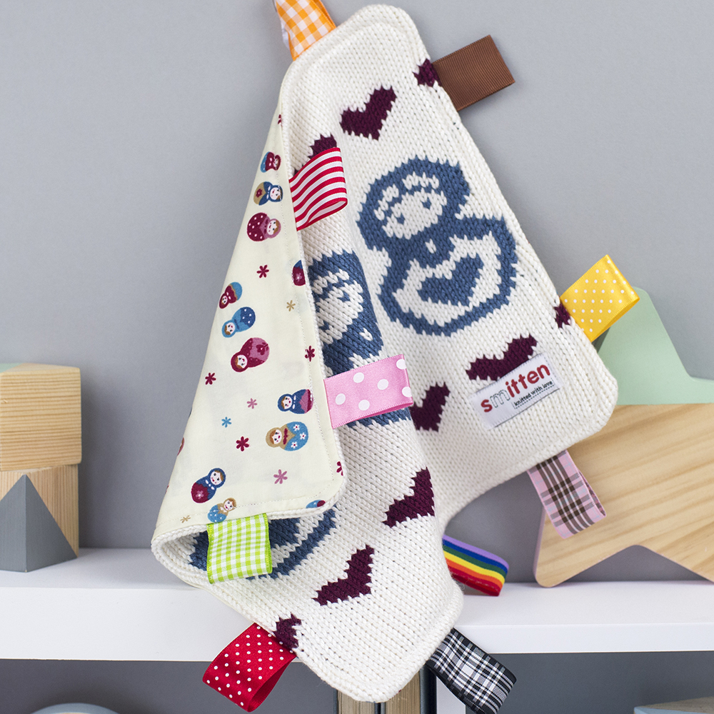 Russian dolls knitted baby comforter