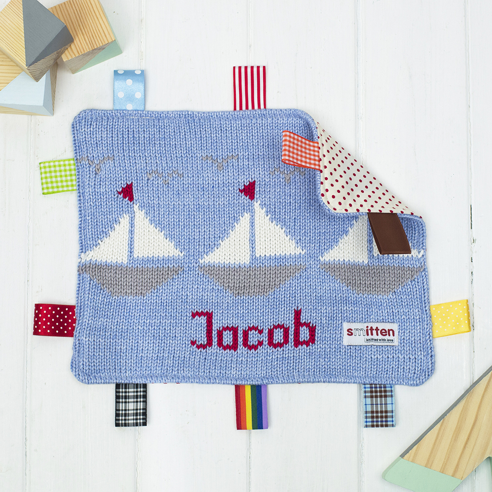 Blue Boats knitted baby comforter