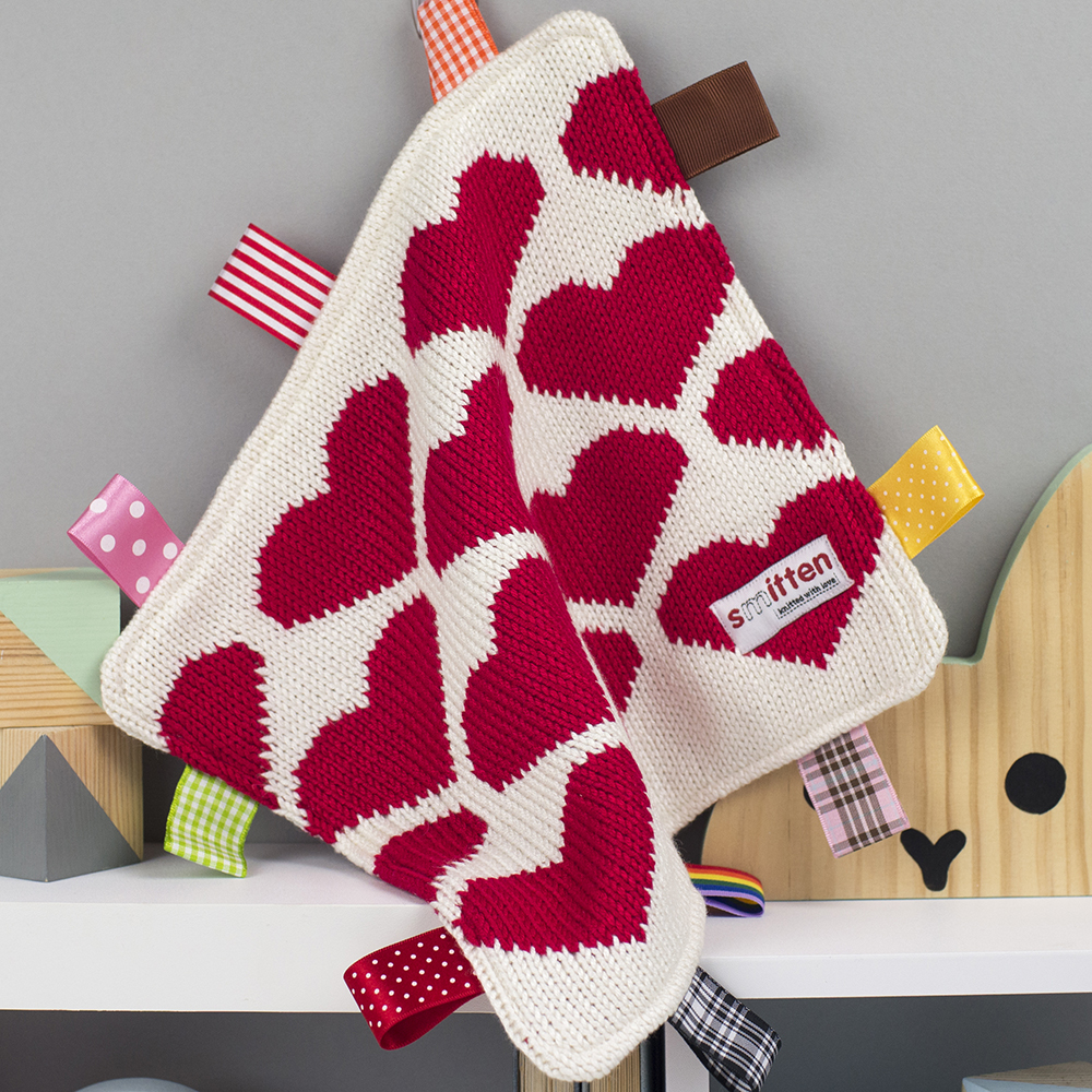 Red hearts knitted baby comforters