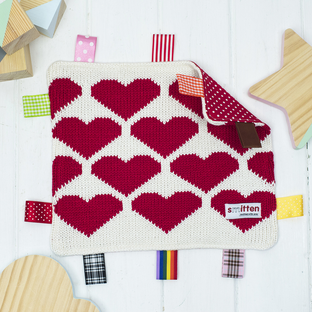 Red hearts knitted baby comforter