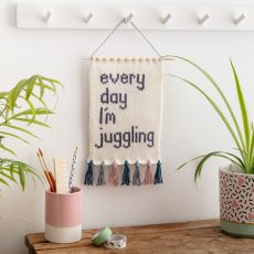 Everyday I'm juggling knitted wall hanging