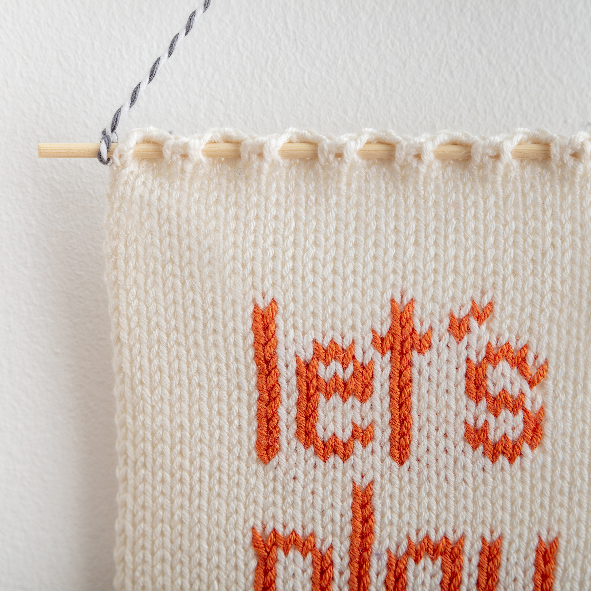 let's play knitted wall hanging