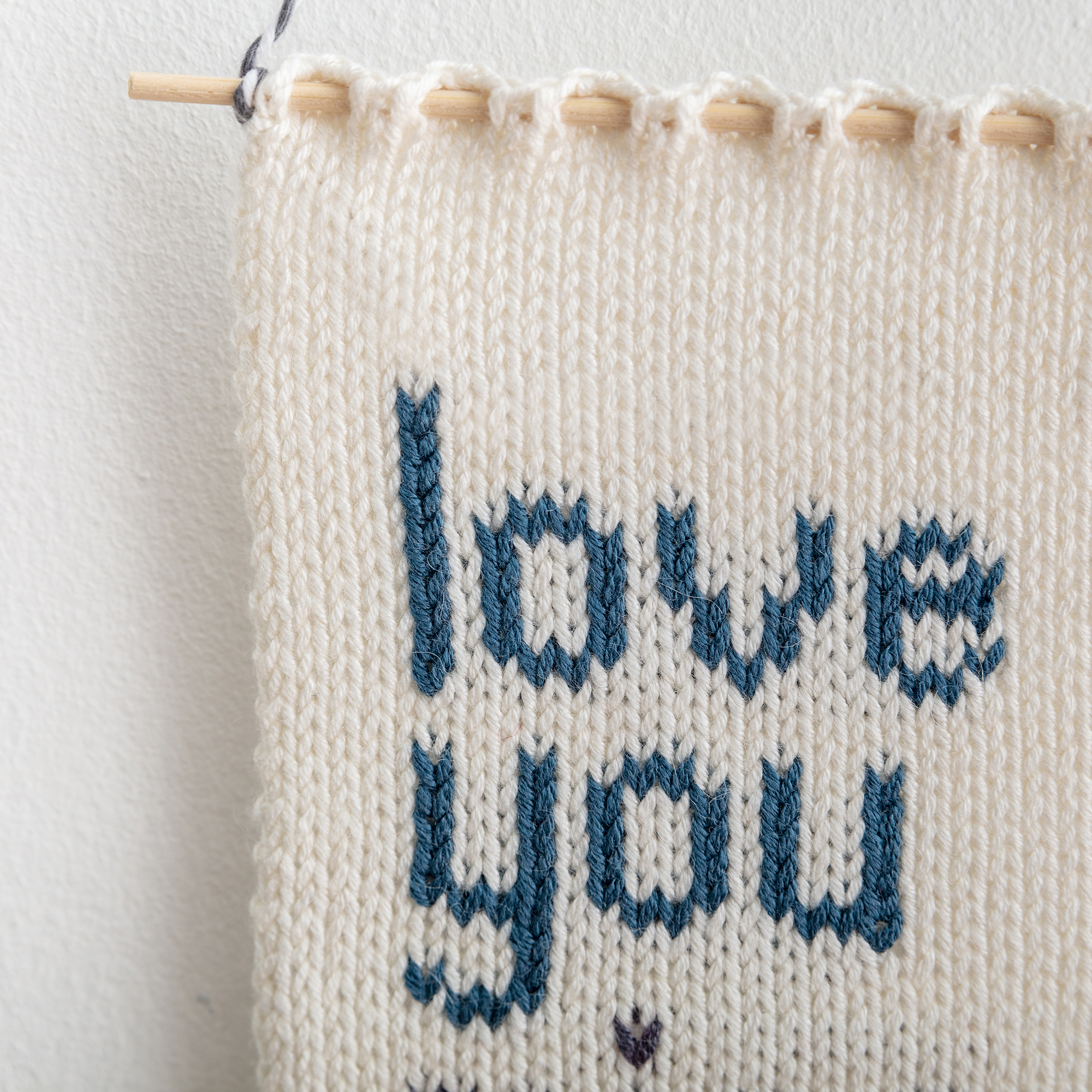 love you miss you knitted wall hanging