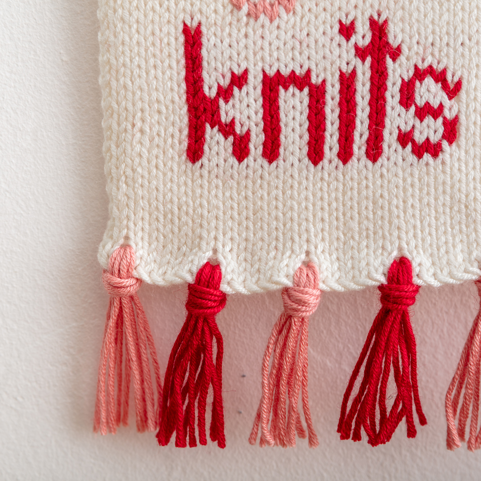 tassels of show me your knits knitted wall hanging